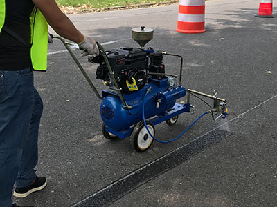 road marking primer machine working