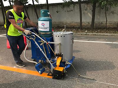 self propelled road marking machine working